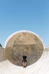 Skateboarder posing in ramp