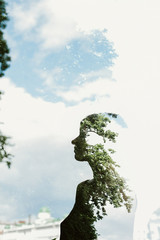 Silhouette of a woman with trees and sky