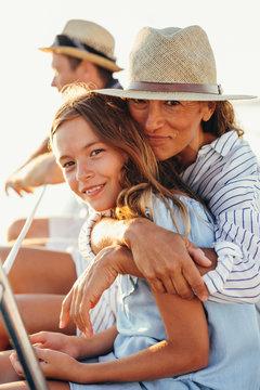 Family enjoying a beautiful sunset on a sailboat.