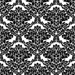 Damask seamless pattern intricate design. Luxury royal ornament, victorian texture for wallpapers, textile, wrapping. Exquisite floral baroque lacy flourish in black and white monochrome colors