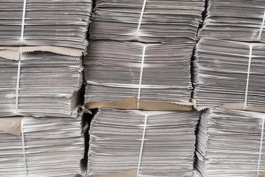 Stacks of newspapers ready to be sold