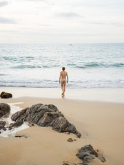 Anonymous nude man going to swim