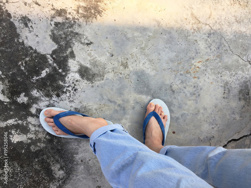 Blue Flip Flop Isolated On Cement FloorTop View Beautiful Woman Wearing Shoes