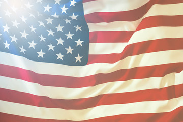 USA flag. American flag blowing wind. Close-up. Studio shot.