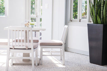 Modern white table and chair set in a cafe