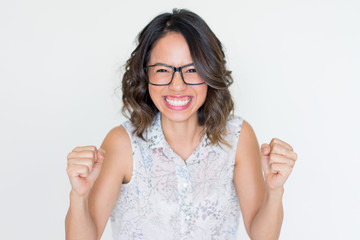 Joyful Asian Girl in Glasses Smiling Broadly