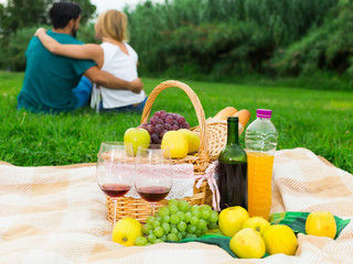 Image of basket with eat for picnic on the grass