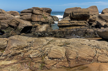 Patterns and Textures on Rocks on Beach Background