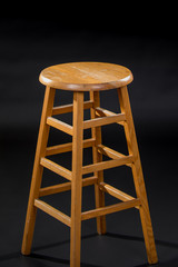 Stool in Studio on Black Backdrop