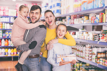 Portrait of family with daughters in food store