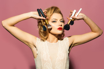 Retro woman with makeup brush, vintage, look.
