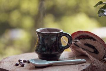 mug of hot morning coffee on the street