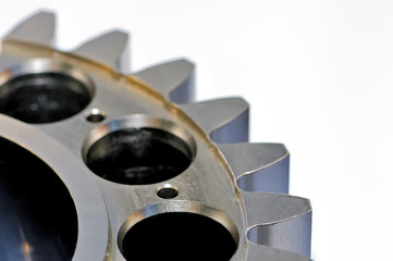 Industrial gear on light background. Close up