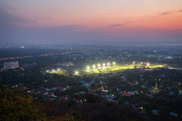 City of Mandalay in Myanmar (Burma), viewed from above from the Mandalay Hill in the evening.
