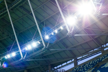 Spotlights on the roof of the stadium