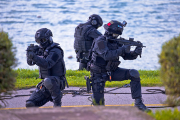 Special forces tactical team of three in action