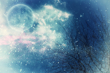 Surreal fantasy concept - full moon with stars glitter in night skies background.