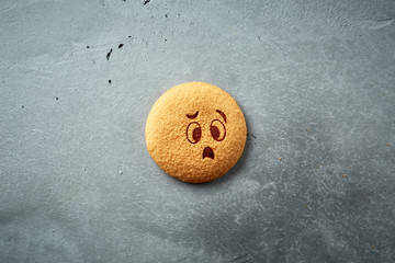 round cookie with emotion, face with emotion