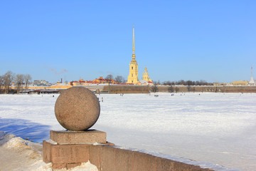 Saint Petersburg (Russia) Winter Cityscape View from Neva River Waterfront and Peter and Paul Fortress. Winter Cold Day Panoramic Outdoor Scene with Blue Sky and Snow, Famous Travel Destination.