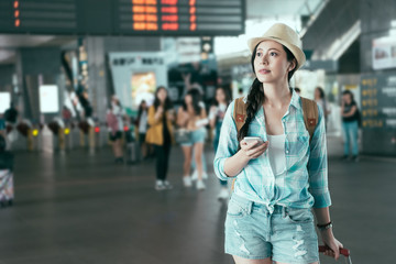 smart Asian woman walking with a luggage