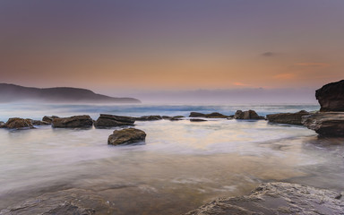 Hazy Dawn Seascape with Rocks