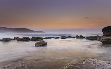 Hazy Dawn Seascape with Rocks