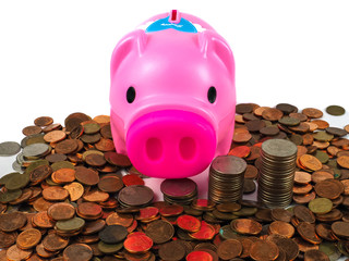 Money saving idea with piggy bank and coin in column.