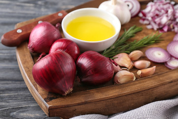 Red onion with garlic on wooden board