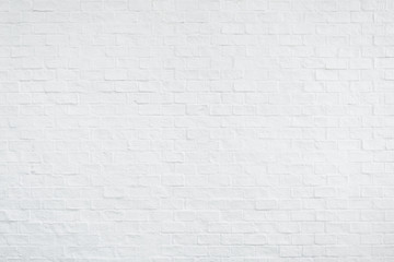 Backdrop of white brick wall texture.