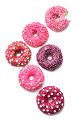 Delicious colorful donuts on white background