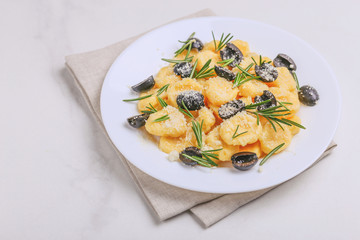 Italian Gnocchi with cream sauce, olives and rosemary