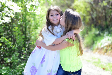 Children pose together on nature background, defocused