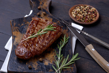 Closeup beef steak and rosemary
