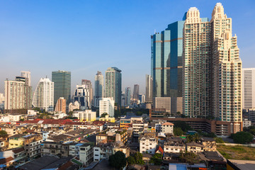 Contrast between new and holding buildings in Bangkok, Thailand skyline