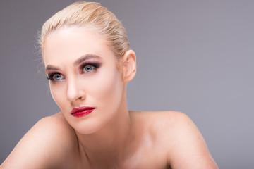 Beautiful young blonde woman wearing glamour make-up.