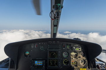 Printed roller blinds Helicopter Dashbord of helicopter while flying above the clouds with a moving blade visible
