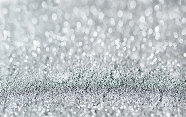 Sparkling festive background. Melting macro snowflakes close up with bokeh at the background. Image...