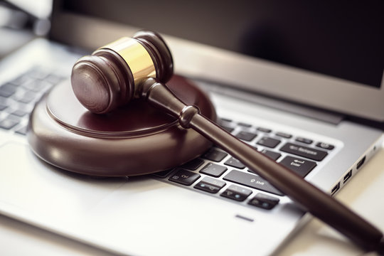 Justice gavel on laptop computer keyboard