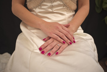 Bride with crossed hands on legs