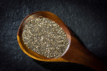 Chia seeds on wooden spoon