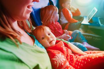family plane travel -mother kids in flight