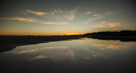 A perfect sunset with it's own reflection in the water in the Uyuni desert