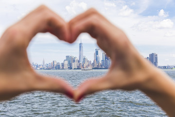 USA, New York, heart-shaped hands in front of Manhattan skyline