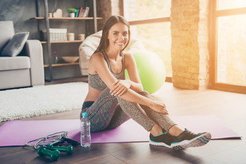 Wellbeing wellness endurance concept. Portrait of excited confident attractive active cheerful with toothy beaming smile skinny muscular woman sitting on purple mat near jump-rope looking at camera
