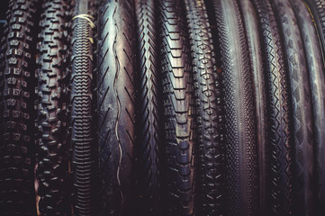 The tires on the bicycle wheel are in a row. selling a piece of mountain bike tires in closeup
