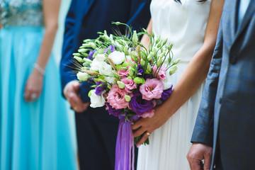Bride Holding Elegant Bouquet
