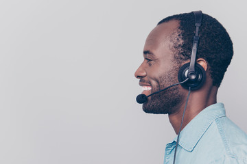 Profile, side view, close up portrait with copy space, empty place for advertisement of confident, joyful, cheerful, stylish guy having headset with mic on head, isolated on grey background