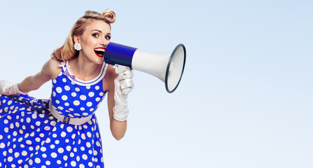 happy woman holding megaphone, dressed in pin-up style