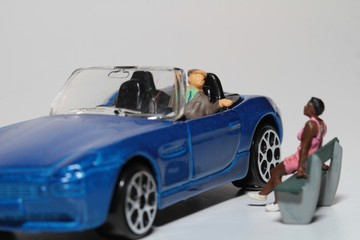 Miniatura di uomo che tratta con prostituta dall'automobile