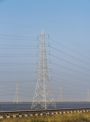 High voltage electrical pole structure on side of Kutch Highway, Gujarat, India
